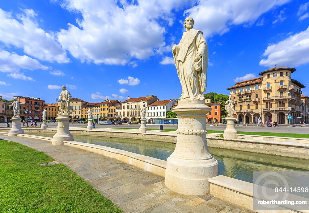 View of statues in Prato della Valle and colourful architecture  in the background, Padua, Veneto, Italy, Europe