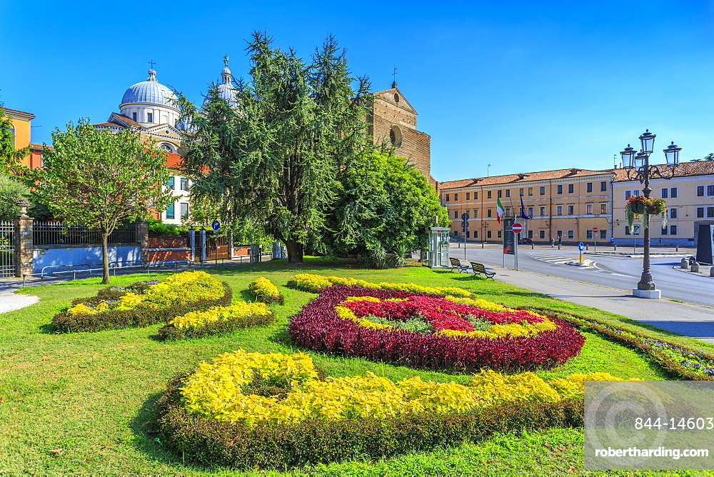 View of gardens in Prato della Valle and Santa Giustina Basilica visible in background, Padua, Veneto, Italy, Europe