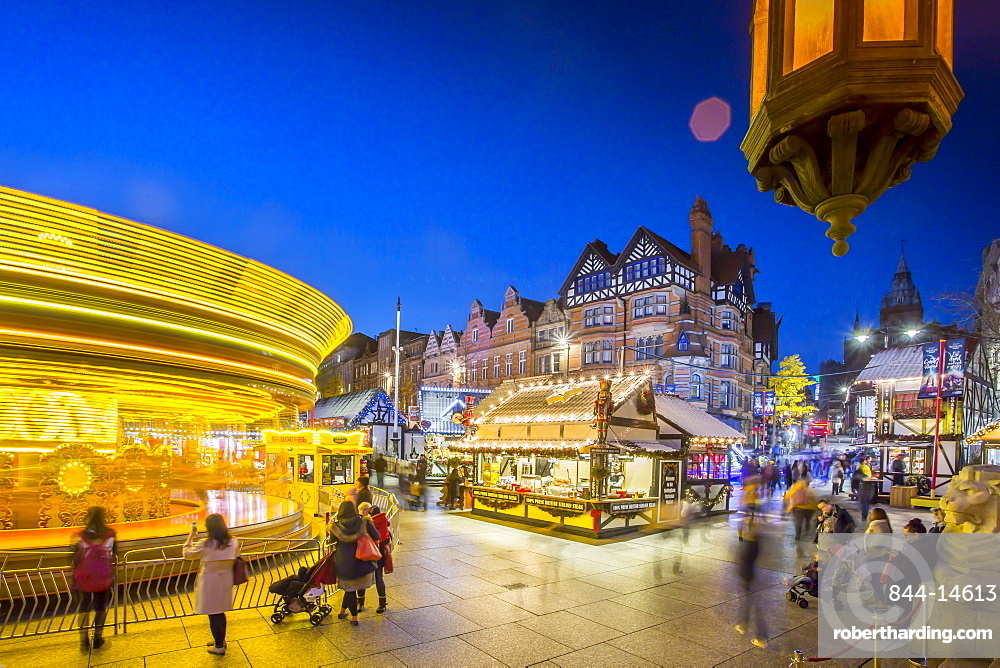 Christmas Market, Carousel and lamp on Old Market Square at dusk, Nottingham, Nottinghamshire, England, United Kingdom, Europe
