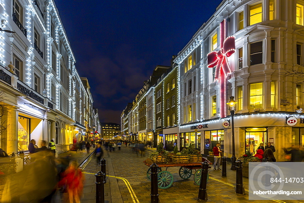 View of Christmas lights adorning Kings Street near Covent Garden at dusk, London, England, United Kingdom, Europe