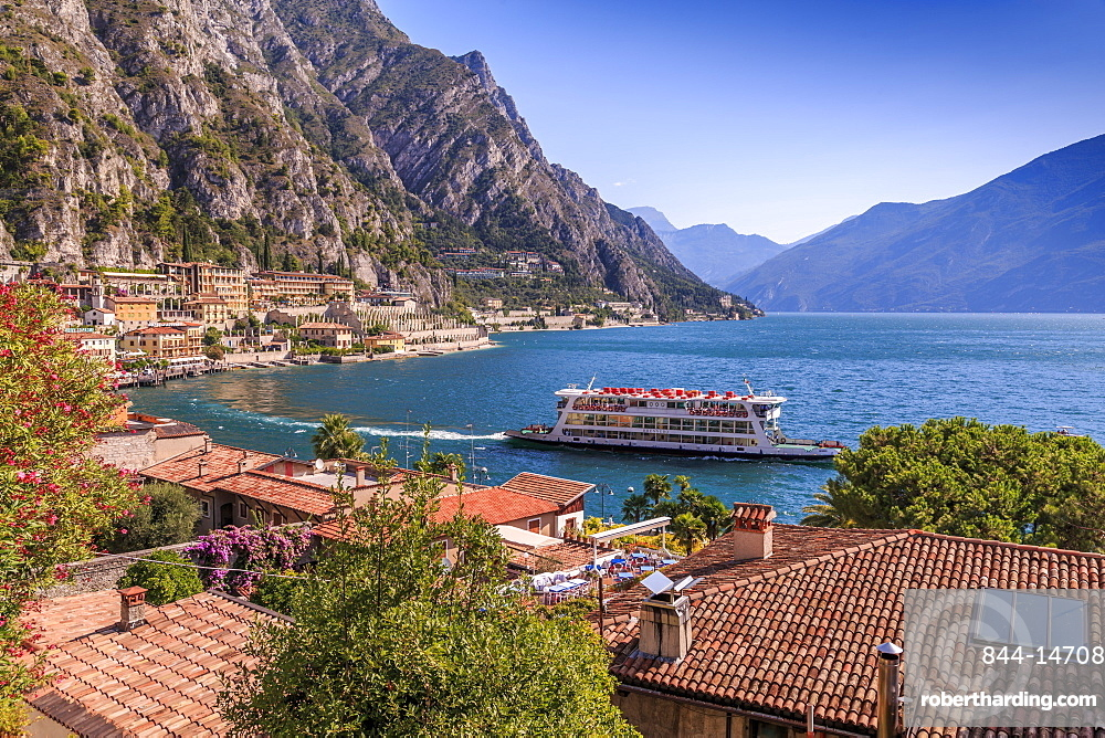 Elevated view of ferry on Lake Garda and rooftops in the port of Limone, Lake Garda, Lombardy, Italian Lakes, Italy, Europe