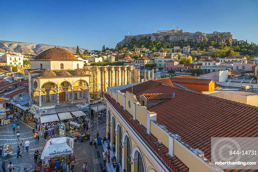 Elevated view of Monastiraki Square with The Acropolis visible in background during late afternoon, Monastiraki District, Athens, Greece, Europe