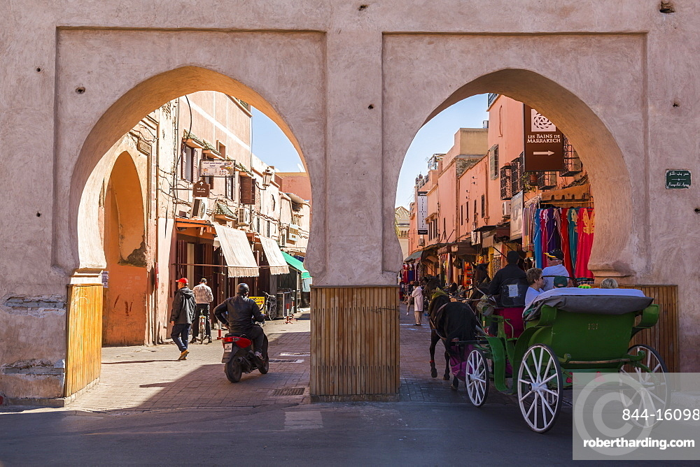View of horse and carriage on the Route du Ourika and city gate visible in background, Marrakesh (Marrakech), Morocco, North Africa, Africa