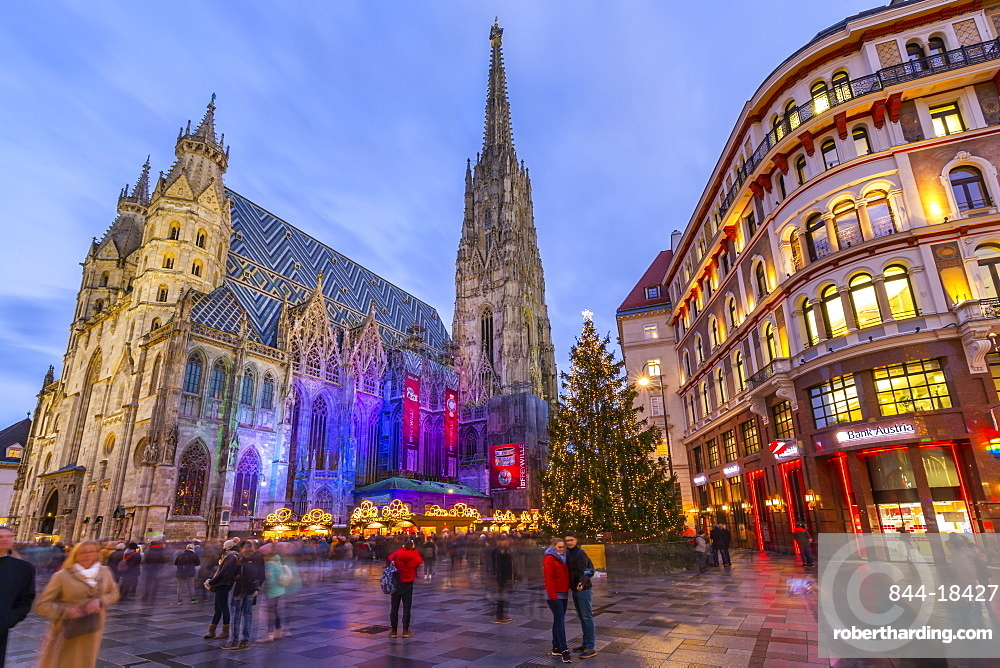 View of St Stephans Cathedral, shops and Christmas tree on Stephanplatz at dusk, Vienna, Austria, Europe