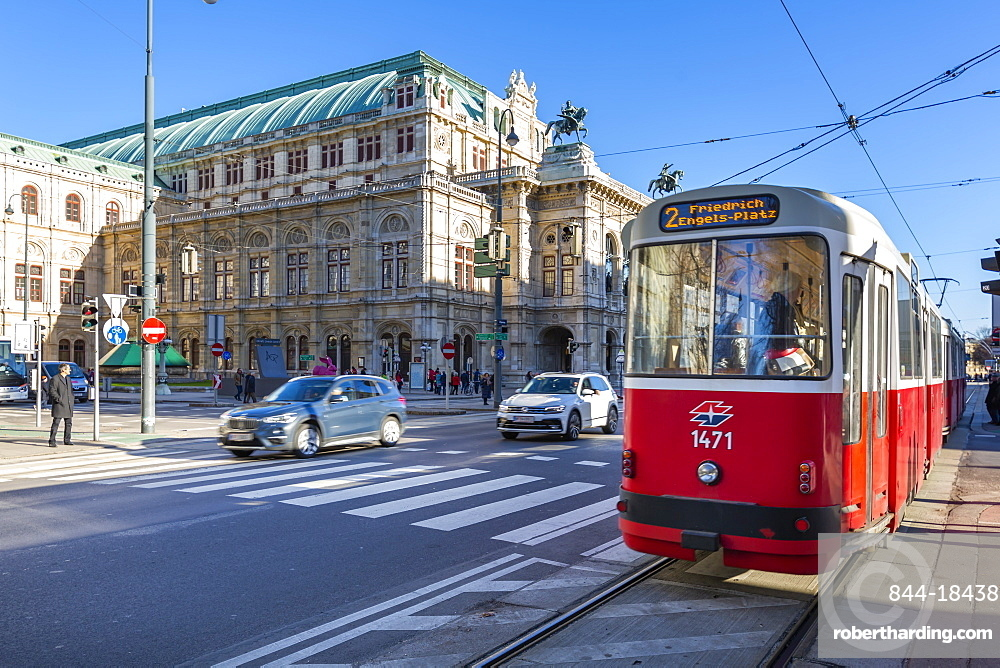 View of Royal Opera House and city tram on Opernring, Vienna, Austria, Europe