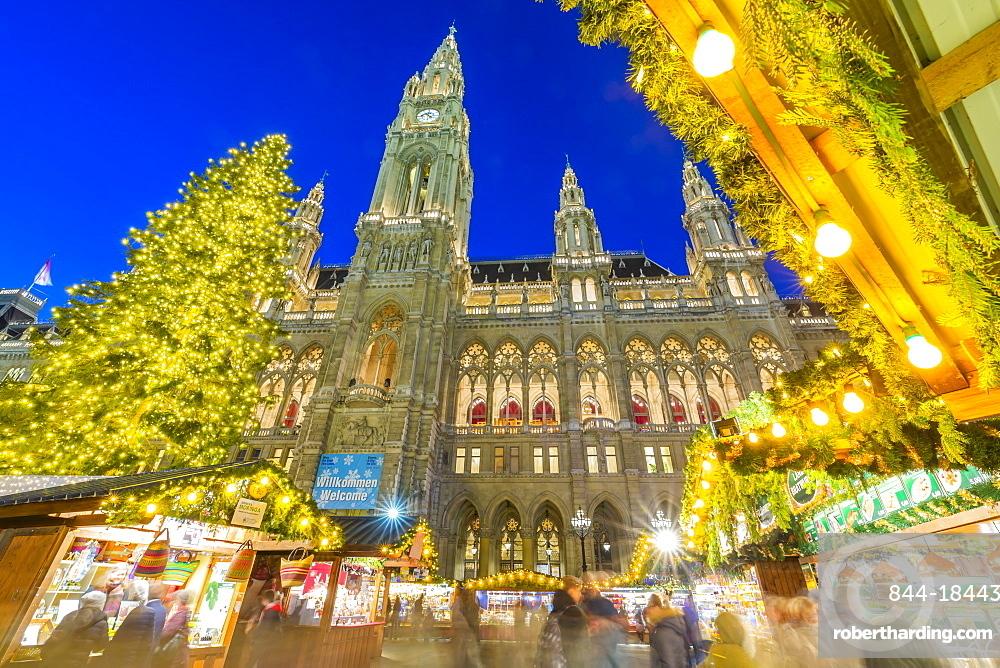 Rathaus and Christmas Market at night in Rathausplatz, Vienna, Austria, Europe