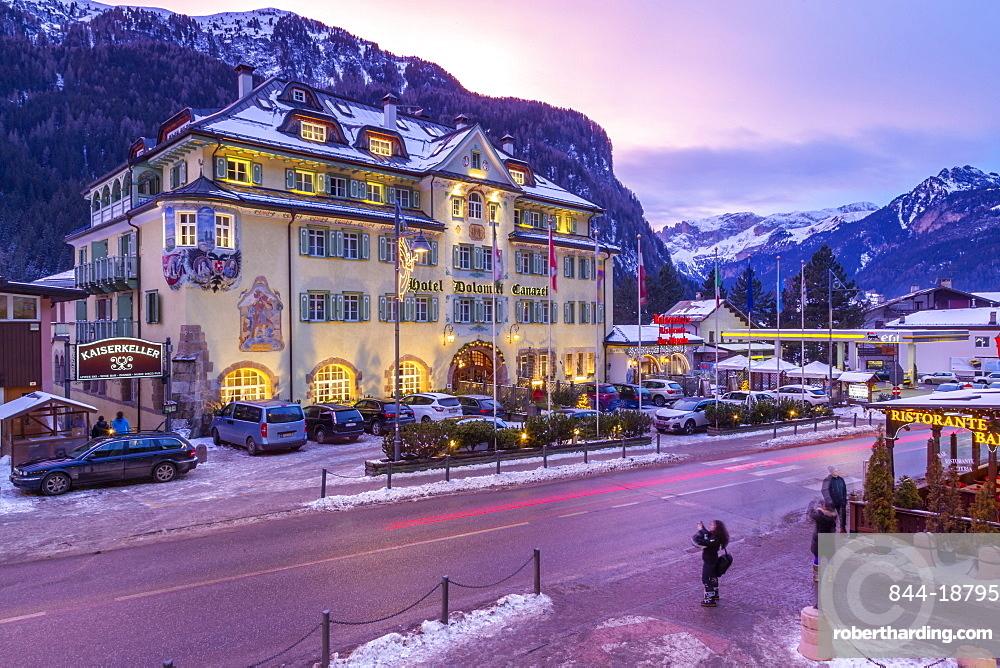 View of Hotel Dolomiti Canazei at dusk in winter, Canazei, Val di Fassa, Trentino, Italy, Europe