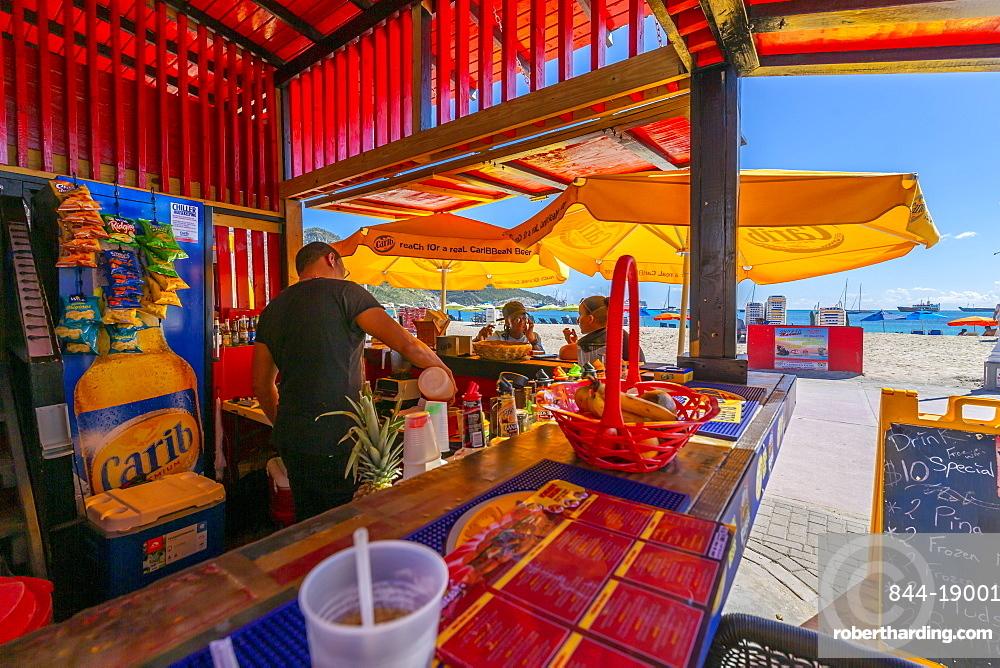 View of beach and Caribbean Sea from beach bar, Philipsburg, St Maarten, Caribbean, Leeward Islands, West Indies, Central America