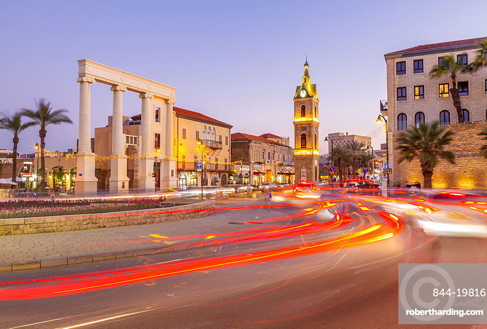 View of The Clock Tower and trail lights at dusk, Jaffa Old Town, Tel Aviv, Israel, Middle East