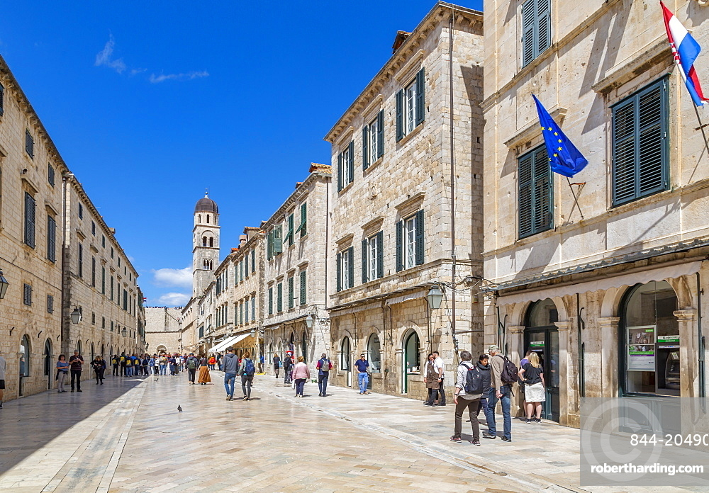 Visitors on Stradun and Franciscan Church and Monastery, Dubrovnik Old Town and Adriatic Sea, Dubrvnik, Dalmatia, Croatia, Europe