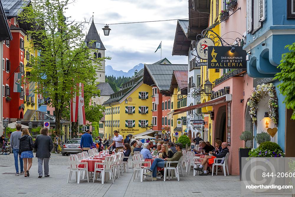 View of visitors enjoying drinks outside cafe on Vorderstadt, Kitzbuhel, Austrian Tyrol Region, Austria, Europe