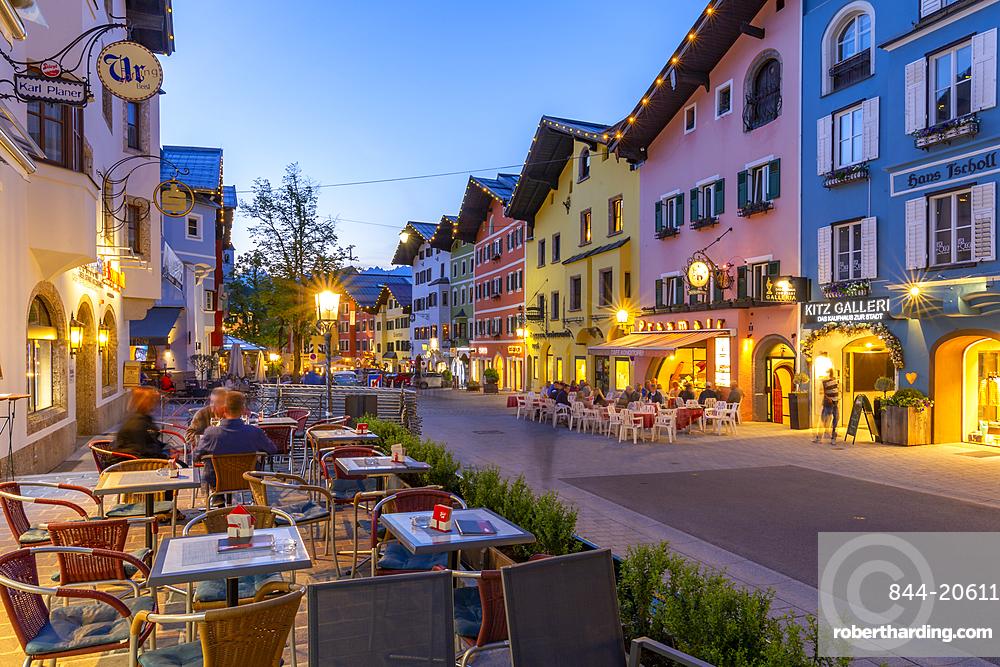 View of architecture and cafes on Vorderstadt at dusk, Kitzbuhel, Austrian Tyrol Region, Austria, Europe