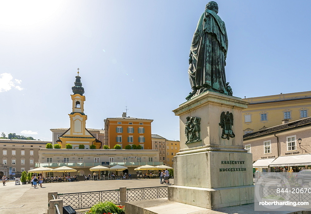 View of St. Michaelskirche and Mozart Statue in Residenzplatz, Salzburg, Austria, Europe