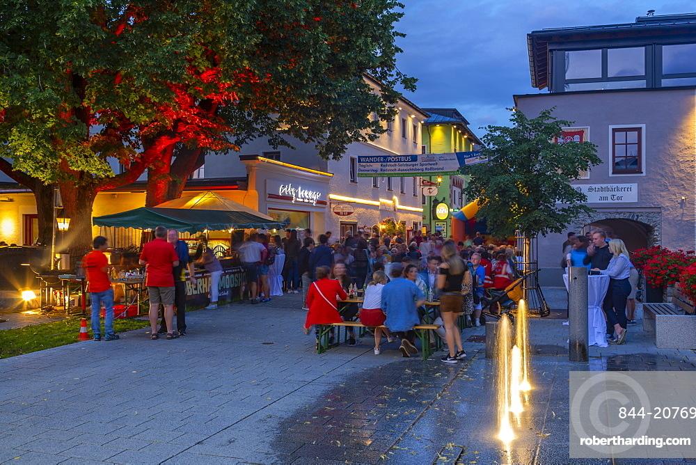View of people enjoying nightlife in Radstadt, Styria, Austrian Tyrol, Austria, Europe