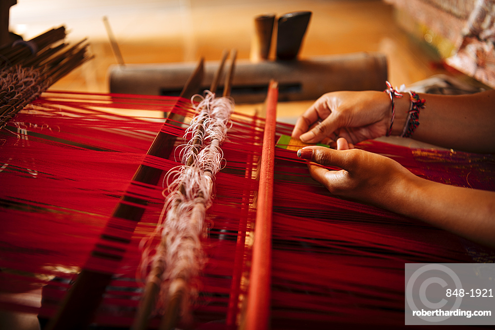 Girl weaving using traditional method, Sidemen, Bali, Indonesia, Southeast Asia, Asia