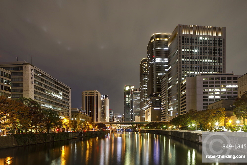 High rise office buildings in the Dotonbori area of Osaka at night, Osaka, Japan, Asia