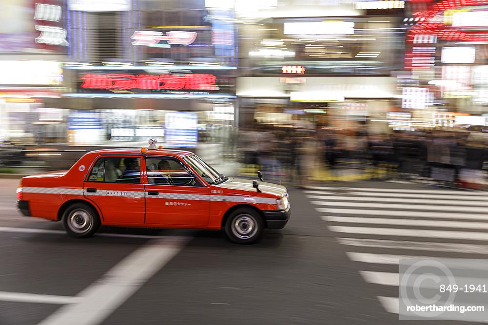 Taxi speeding through the streets of Shinjuku, Tokyo.