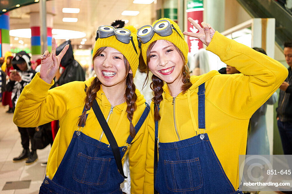Young Japanese girls dressed as Minions at the Halloween celebrations in Shibuya, Tokyo