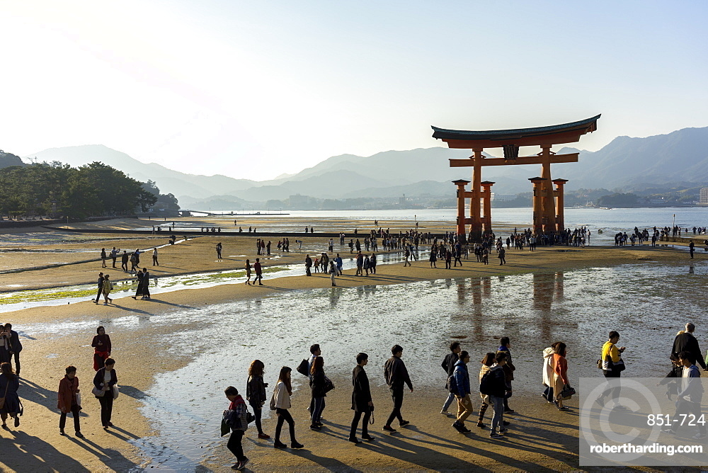 The red wooden torii gate at low tide on Miyajima island, Itsukushima, UNESCO World Heritage Site, Hiroshima Prefecture, Honshu, Japan, Asia