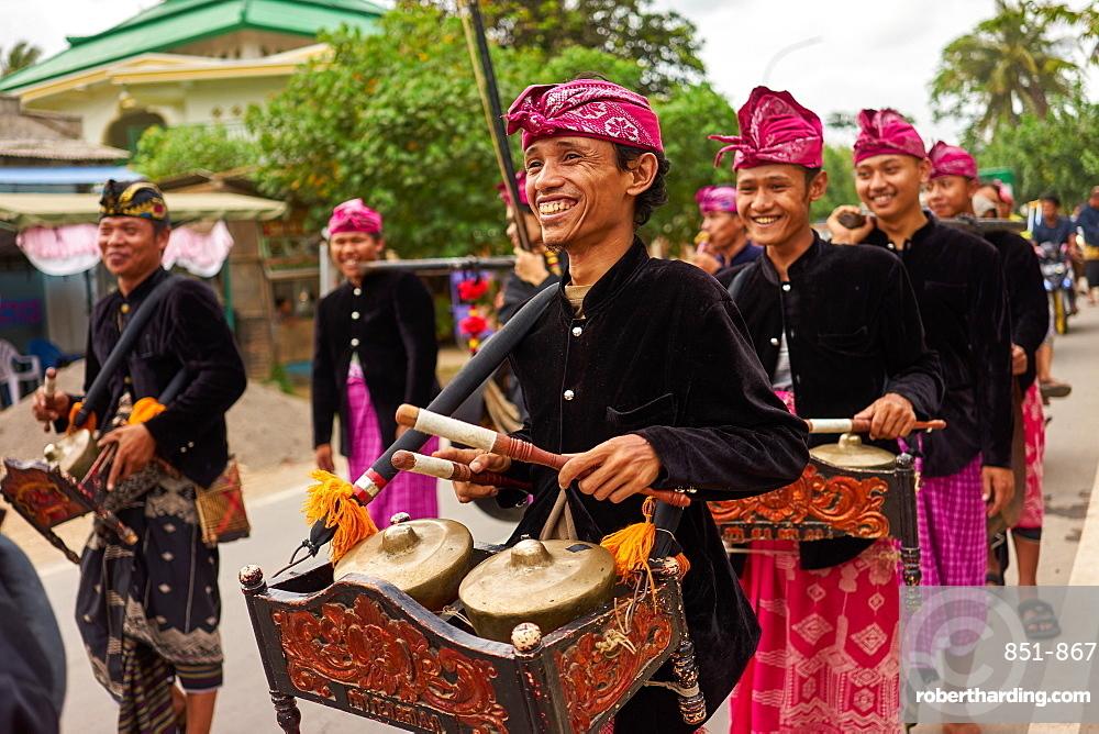 Musicians leading a traditional Sasak wedding procession, Lombok, Indonesia, Southeast Asia, Asia