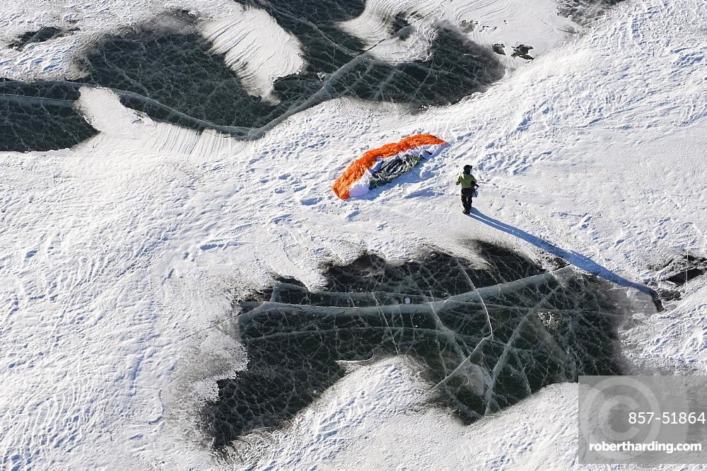 A snowkiter setting up their snowkite on the frozen Missouri River in North Dakota.
