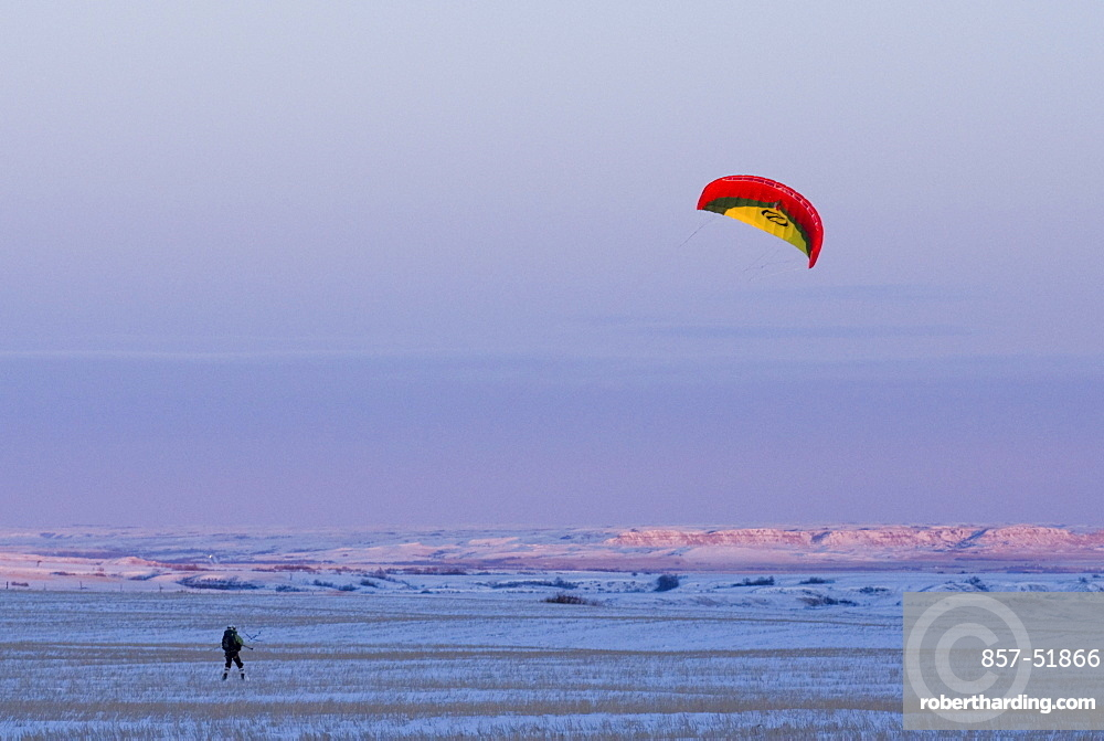 Snowkiting in North Dakota with the last light of day during the 2XtM expedition.