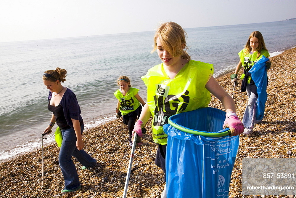 UK - Littlehampton - Volunteers move down the beach collecting debris during the International Costal Clean-up effort.