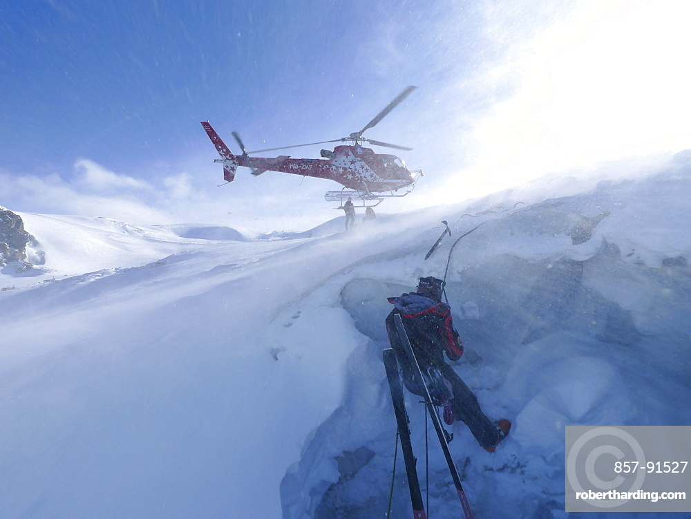 A mountain rescue technician is descending into a crevasse. When a skier breaks through the snow and tumbles down the glacier, the only way out is being winched out by the rescuers of Air Zermatt.