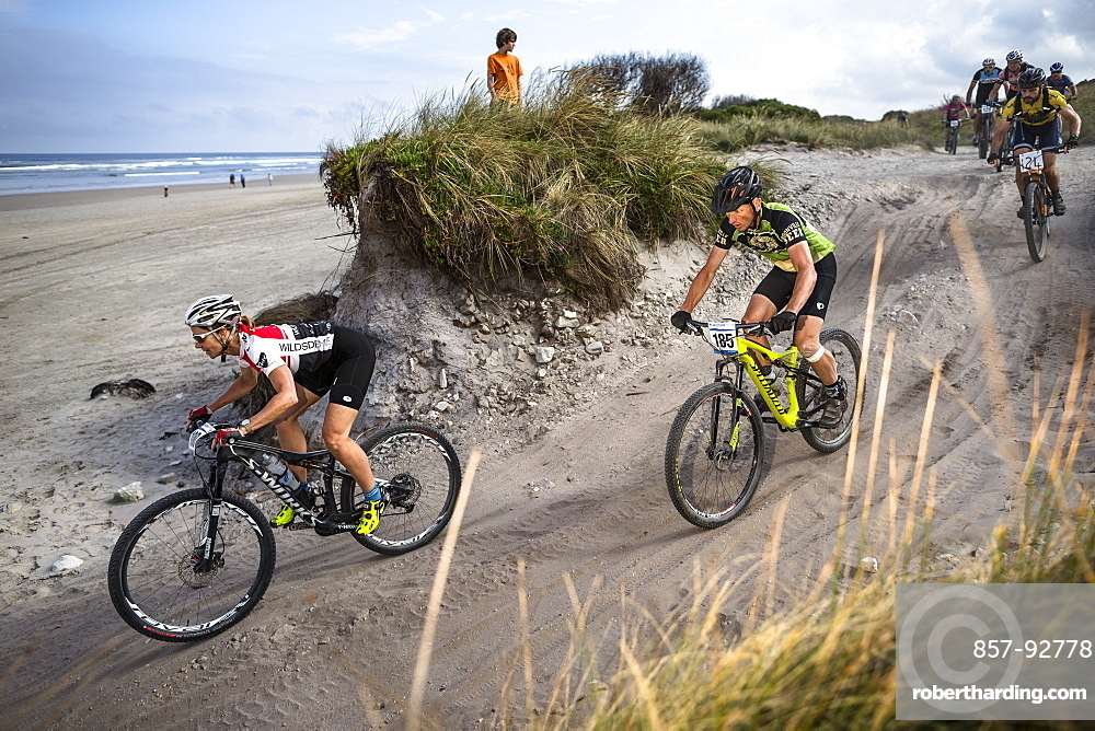 Mountain bikers merge onto Ocean Beach during the last stage of Wildside MTB 2016 in Tasmania.