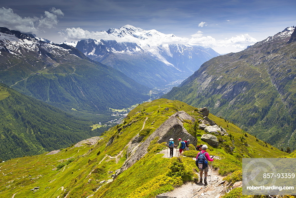 Hikers Are Descending From Aiguillette Des Posettesinto The Chamonix Valley
