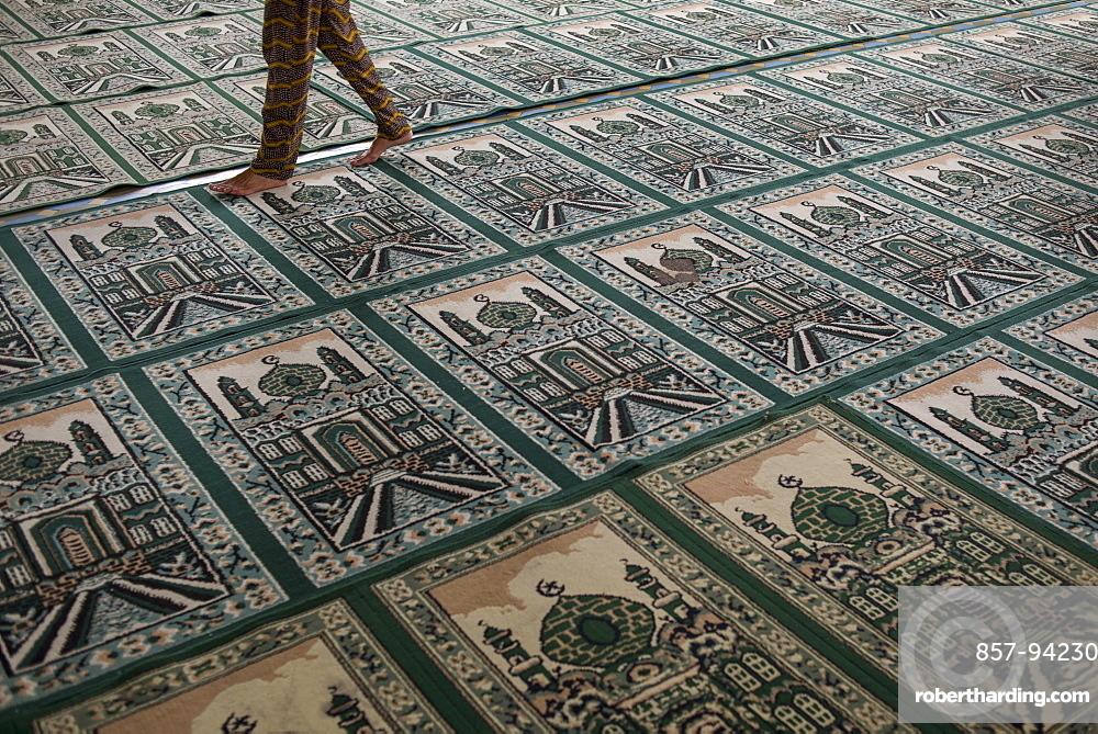 A Person Walking On Top Of Muslim Praying Carpet Inside The Grand Mosque, Medan, Sumatra, Indonesia