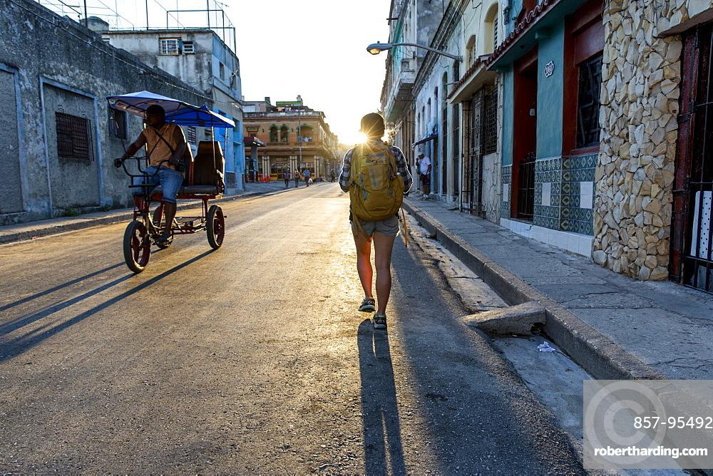 Rear view of female tourist walking in street of Havana, Cuba