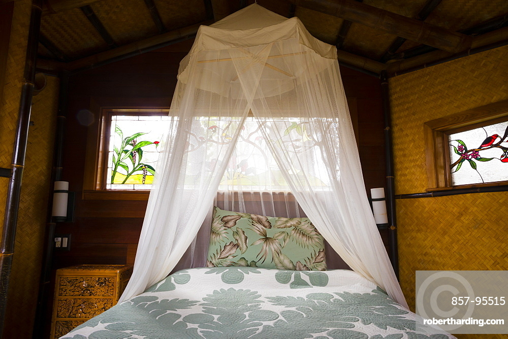 Honeymoon suite with a king bed at a treehouse in the rainforest near Hilo and Volcano on the Big Island of Hawaii