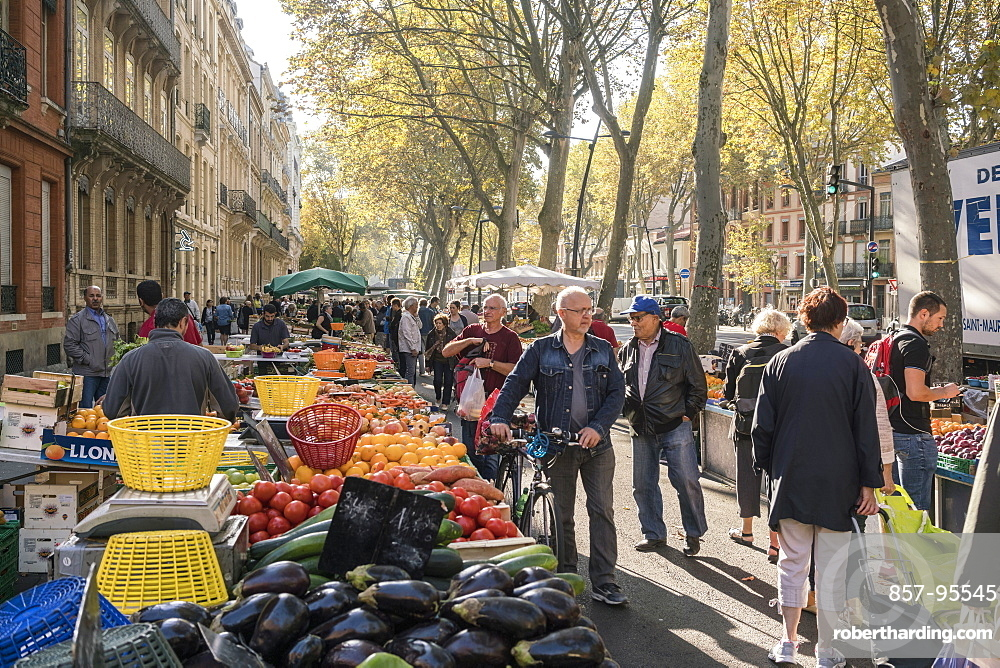 Crowded food street market and part of tenement house, Toulouse, Occitanie, France