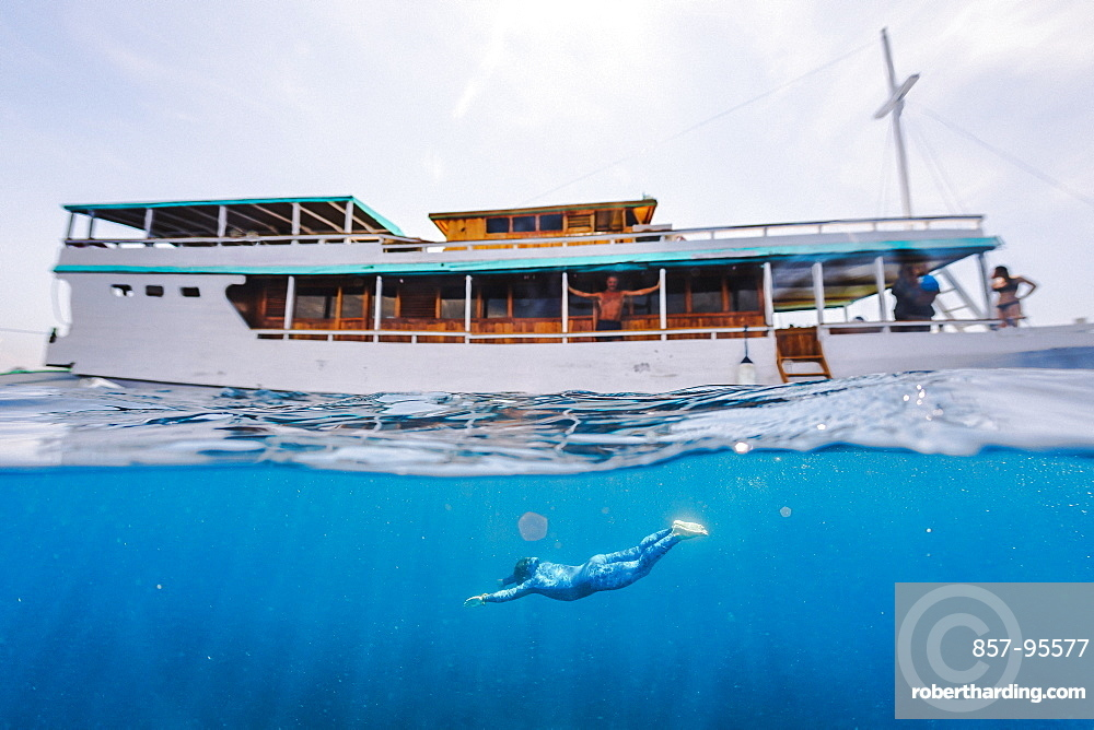 Freediving under a boat, Komodo, Nusa Tenggara Timur, Indonesia