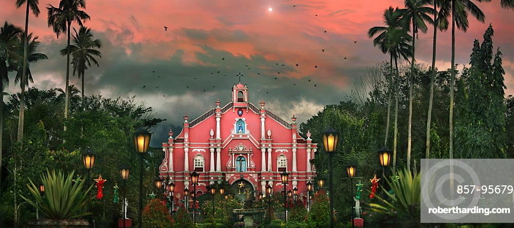 Building exterior of colonial style church among palm trees at Villa Escudero Plantation, Laguna, Luzon Island, Philippines