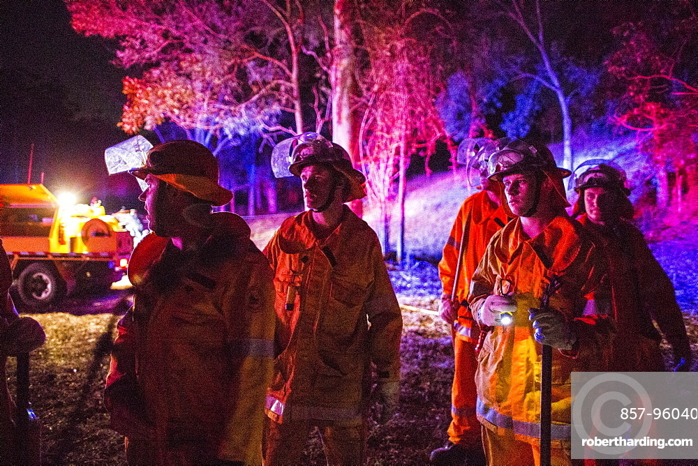 Firefighters waiting for approval from Incident Control to put fire on the ground, Guanaba, Queensland, Australia
