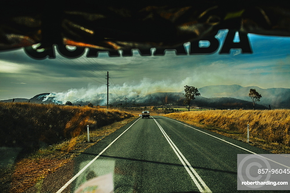 View from fire engine approaching bush fire, Esk, Queensland, Australia