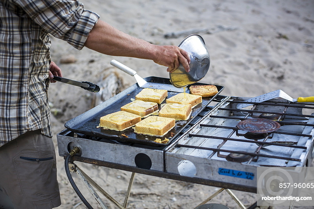 French toast getting made in an outdoor kitchen during a Green river rafting trip, Desolation/Gray Canyon section, Utah.