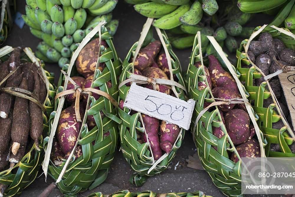 Baskets of sweet potato (Ipomea batatas) on the market of Port Vila, Efate Island. Vanuatu.