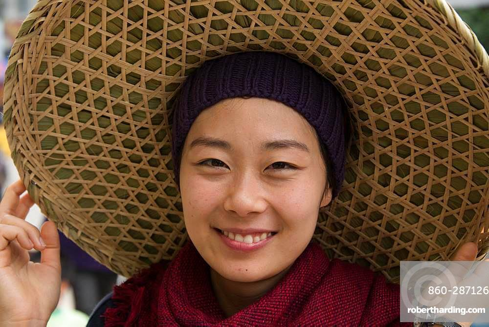 Korean teen girl with Chinese hat in Yunnan region of China