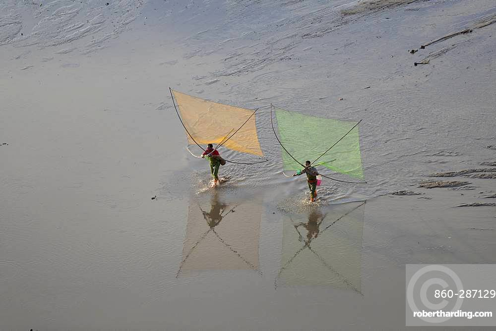 Fishermen on foot, shrimp fishing with net, Xiapu County, Fujiang Province, China