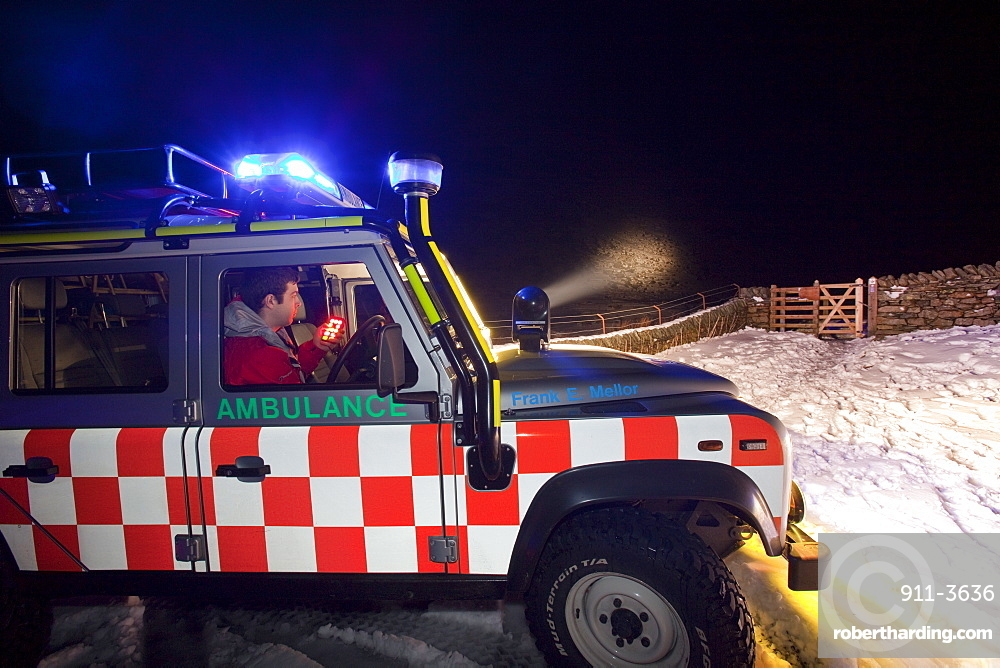 A Langdale Ambleside Mountain Rescue Team Landrover out at night below Red Screes in the Lake District, Cumbria, England, United Kingdom, Europe