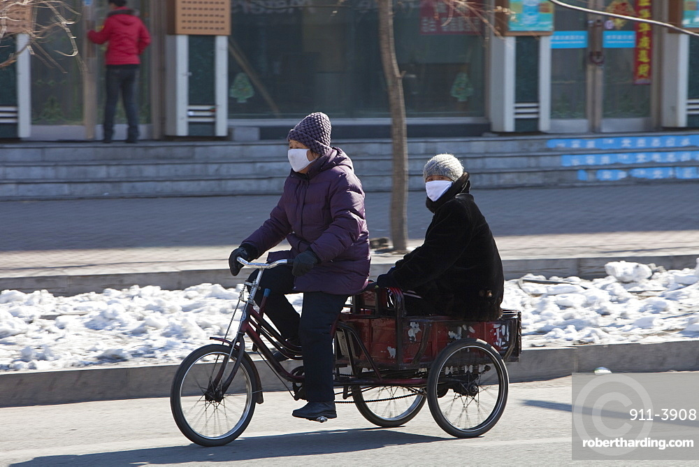 People wear face masks against the awful air pollution in Suihua city, Heilongjiang, Northern China, Asia