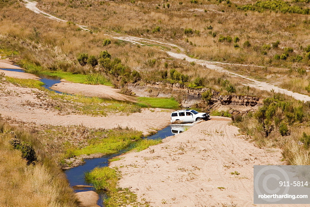 Off road vehicle at Lake Eildon after an uprecedented ten years of drought, with only 29 percent capacity, Victoria, Australia, Pacific