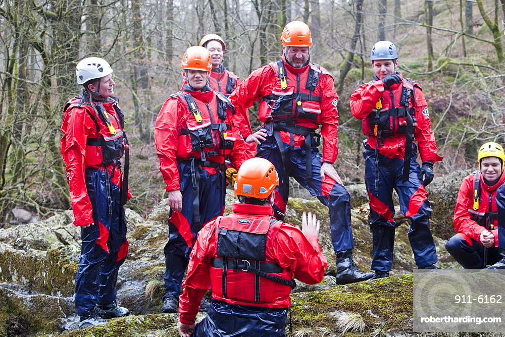 Members of the Langdale Ambleside Mountain Rescue Team train in Swift water rescue techniques on the River Brathay at Skelwyth, Lake District, Cumbria, England, United Kingdom, Europe