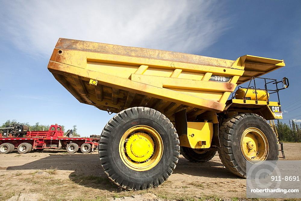 Massive dump trucks by the Syncrude upgrader plant, Alberta, Canada, North America
