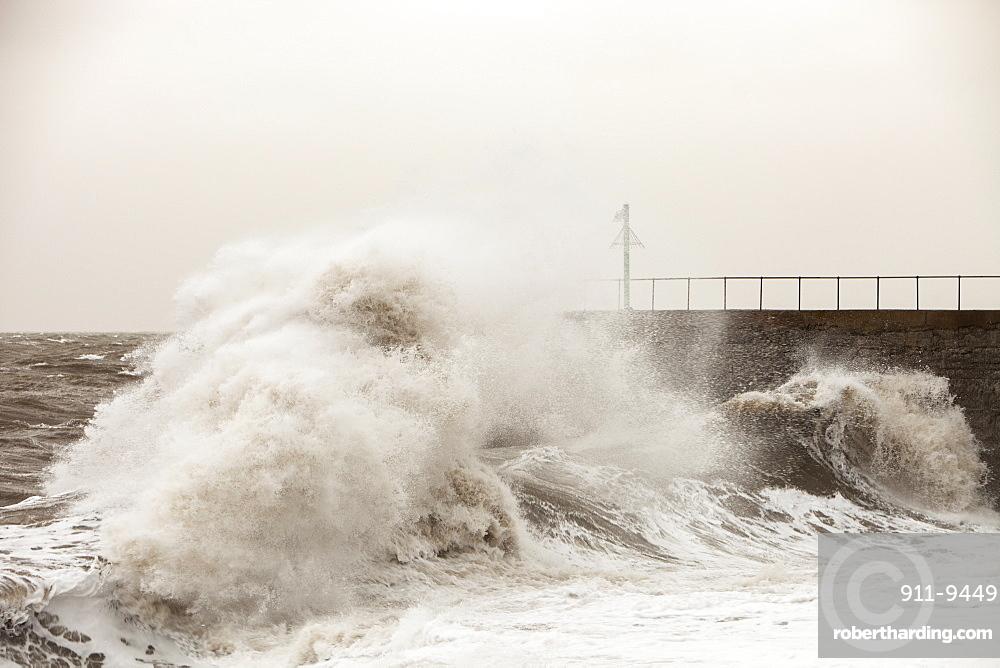 Gale force winds and crashing waves battering the coastal defences in Harrington, Workington, Cumbria, England, United Kingdom, Europe