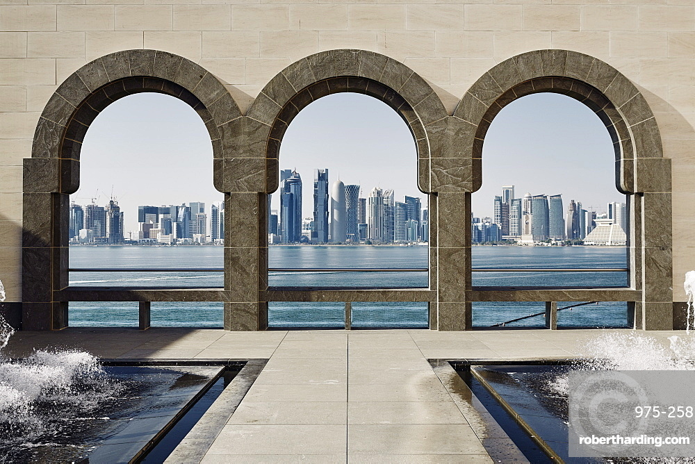 Downtown Doha with its impressive skyline of skyscrapers as seen from the Museum of Islamic Arts, across the bay, Doha, Qatar, Middle East