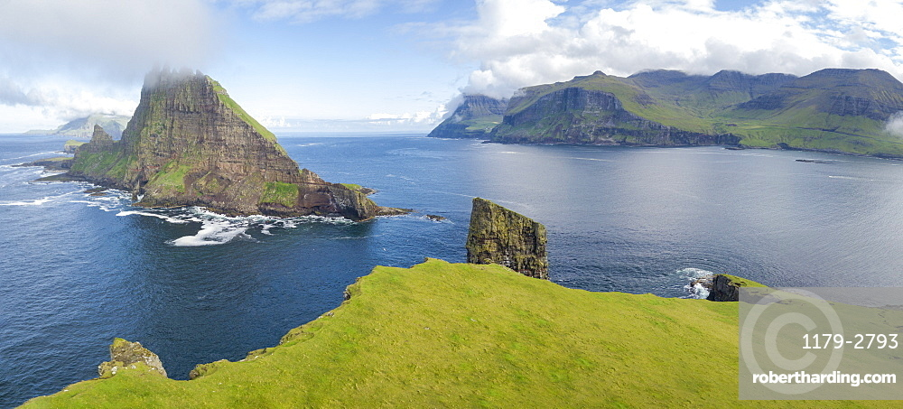 Panoramic of Drangarnir and Tindholmur islet, Vagar Island, Faroe Islands, Denmark, Europe (Drone)